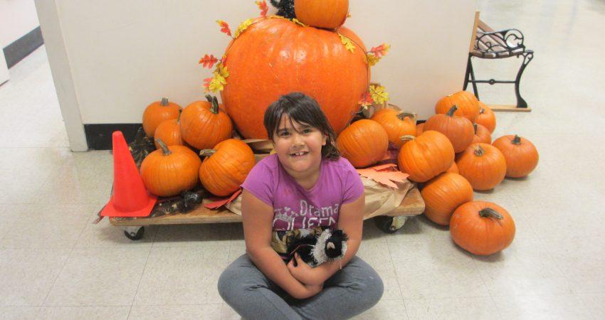Shara, the lucky winner of a giant pumpkin from Fairways